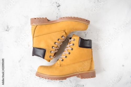 Fototapeta Women's winter boots. Yellow warm boots for trekking obraz
