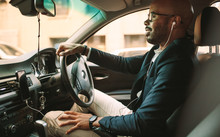 African Businessman Driving A Vehicle To Office