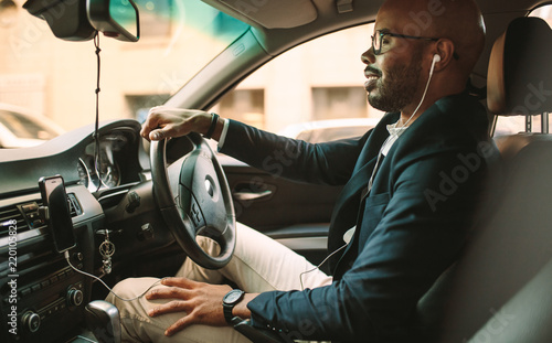 Fotografie, Obraz  African businessman driving a vehicle to office