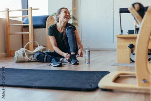 Fototapeta Woman at a pilates gym getting ready to leave obraz