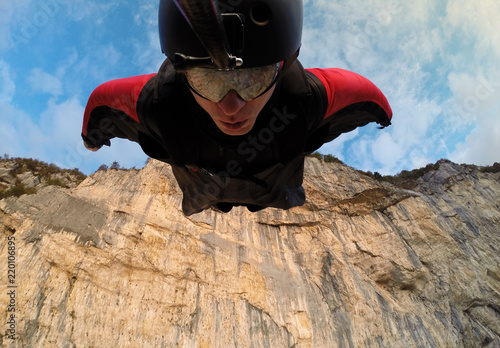 Fotografie, Obraz  self-portrait of the base jumper in flight from the cliff, base jumping, wingsui