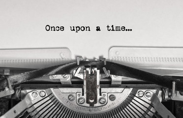 once upon a time... the text is typed on a vintage typewriter with black ink on old paper, close-up