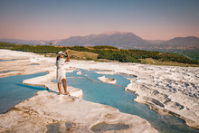 The Enchanting Pools Of Pamukkale In Turkey. Pamukkale Contains Hot Springs And Travertines, Terraces Of Carbonate Minerals Left By The Flowing Water. The Site Is A UNESCO World Heritage Site.