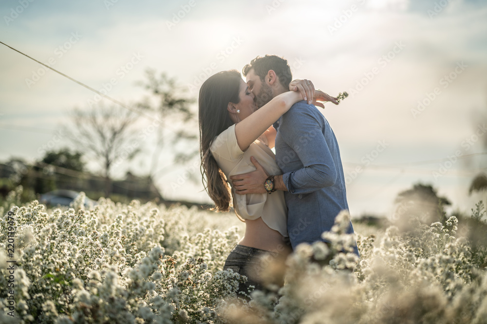 Fototapety, obrazy: Romantic Couple Exploring a field of flowers