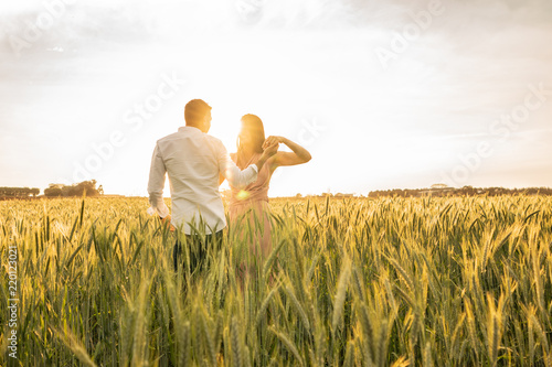 Fotografija  Romantic Couple Dancing on Love Moment at gold wheat field