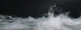 Realistic dry ice smoke clouds fog overlay. copyspace for your individual text.