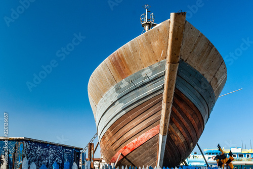 Repairs on the bow of a fishing boat in dry dock at the port of Essaouira in Mor Fotobehang