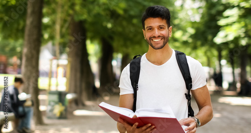 Carta da parati Smiling student outdoor in a college courtyard