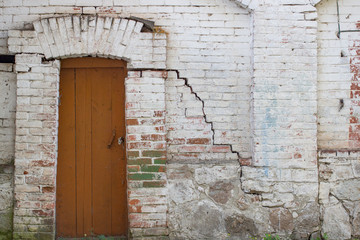 Fototapeta na wymiar Large brown wooden door on a white wall