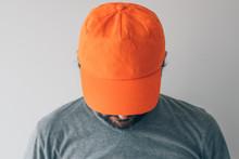 Man Wearing Orange Baseball Ca...