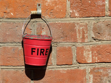 Red Fire Bucket Hanging On A O...