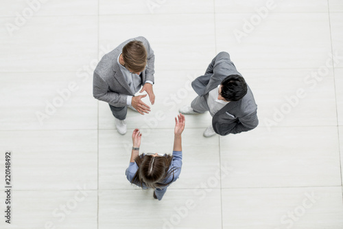 Obraz top view.business people discussing problems - fototapety do salonu