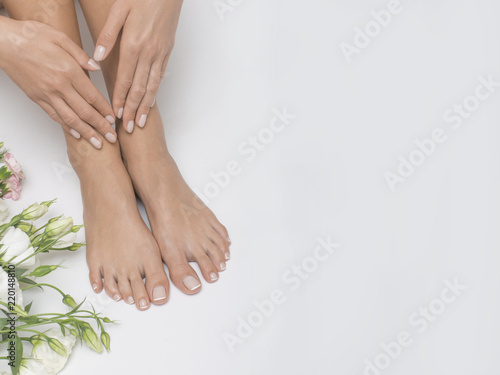 Foto op Canvas Pedicure The picture of ideal done manicure and pedicure. Female hands and legs in the spa spot.