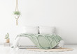 canvas print picture Home bedroom interior mockup with bed, green plaid, pillows, rug and plants on empty white wall background. 3D rendering.