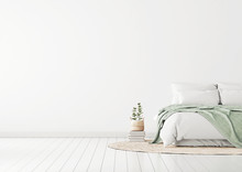 Home Bedroom Interior Mockup With Bed, Green Plaid, Pillows, Rug And Plants On Empty White Wall Background. Free Space On Left. 3D Rendering.