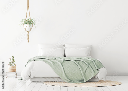 Fotografija  Home bedroom interior mockup with bed, green plaid, pillows, rug and plants on empty white wall background