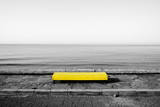 Yellow bench on black and white sea background - 220154859