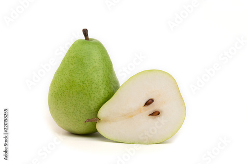 Photo Green pear and half on isolated white background
