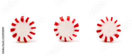 Three Round Peppermints on a White Background