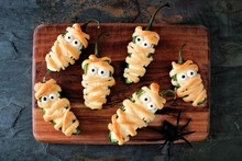 Homemade Halloween Mummy Jalapeno Poppers, Top View On Wooden Server With Spiders