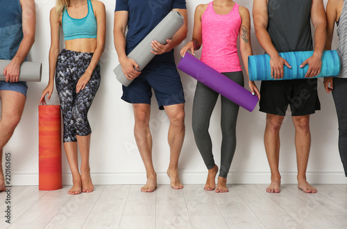 Fototapeta Group of young people waiting for yoga class obraz