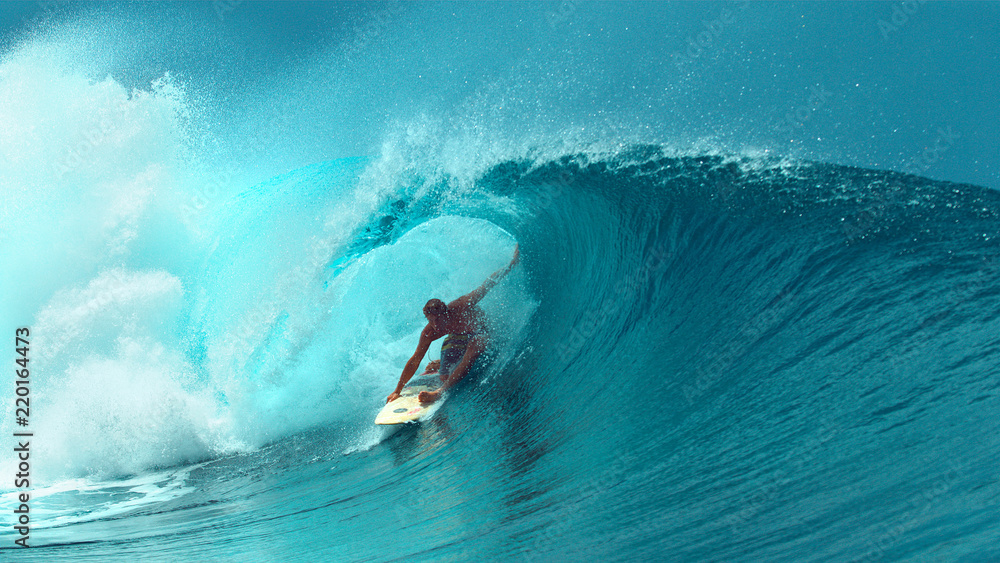 Fototapeta CLOSE UP: Professional surfboarder finishes riding another epic tube wave.