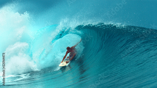 Obraz na plátně  CLOSE UP: Professional surfboarder finishes riding another epic tube wave