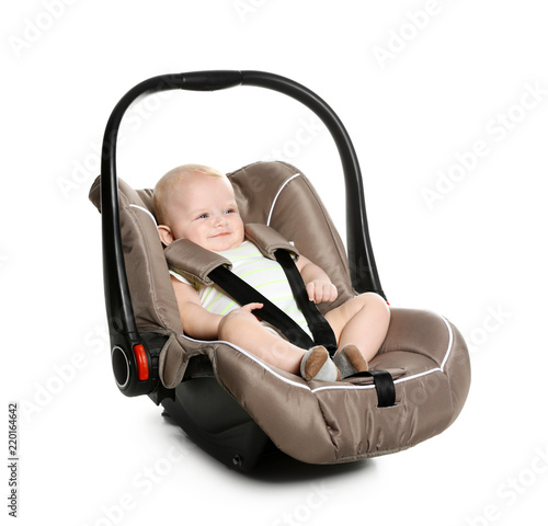Fényképezés Adorable baby in child safety seat on white background