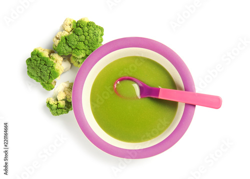 Plate with healthy baby food and broccoli on white background, top view
