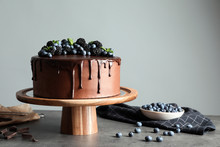 Fresh Delicious Homemade Chocolate Cake With Berries On Table Against Gray Background. Space For Text