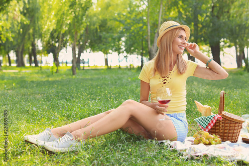 Happy woman having picnic in park on sunny day