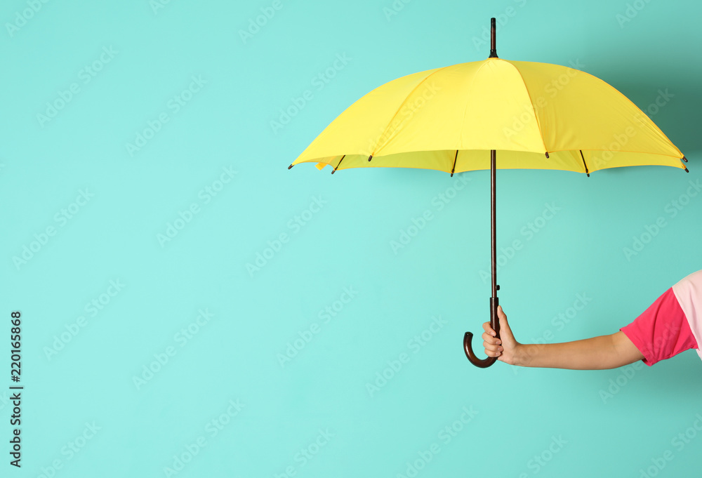 Fototapeta Woman holding beautiful umbrella on color background with space for design