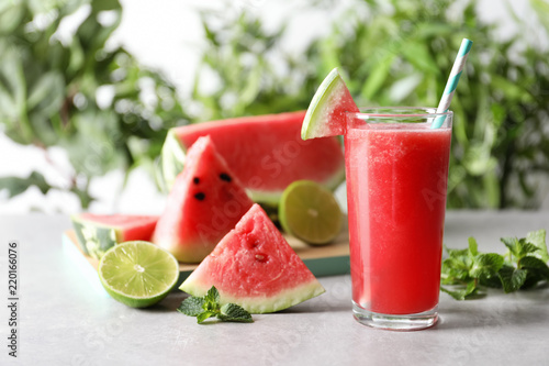 Tasty summer watermelon drink in glass and fresh fruits on table