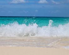 Wave Crashing On Beach