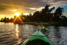 Kayak On A Lake At A Fiery Sun...