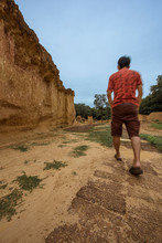 A Man Walking Through The Trail In Phae Muang Phi Canyon Park, Phrae Thailand
