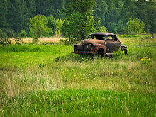 Abandoned Deserted Rusty Old Classic Car In A Farm Field In Northern Minnesota.