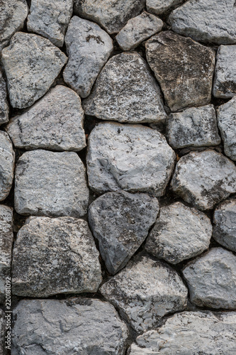 Tuinposter Stenen Closeup of Gray strong stone wall texture