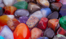 Close-up Polished Tumbled Stones Background