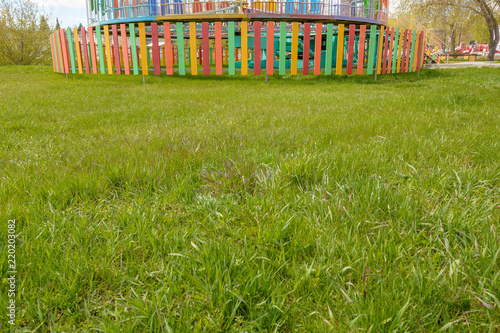 Foto  Copyspace with green grass and attractions on the background