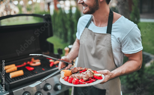 Photo  Man making barbeque