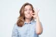 Leinwandbild Motiv Woman zipping her mouth shut - keeping quiet concept