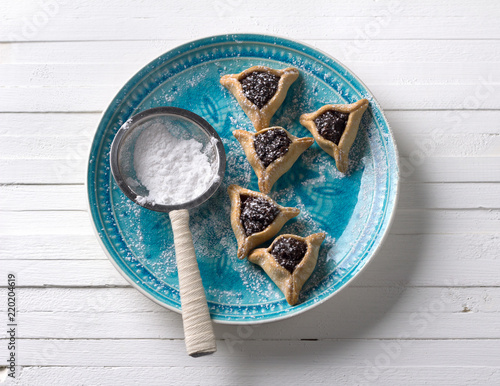 Hamantashen cookies, Haman's ears, traditional sweet pastry with poppy seeds and raisins for the Jewish holiday Purim