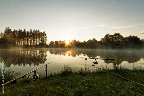 Carp fishing rods misty lake.