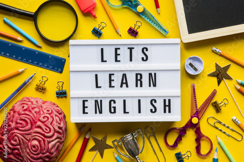 Fotografie, Obraz  Lets learn english lightbox message on a bright yellow background
