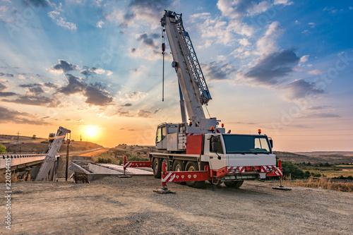 Fotografie, Obraz  Crane trucks in the construction of a bridge