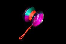 Colorful Bright  Yo Yo.  Toy Yo-yo. Black Background.