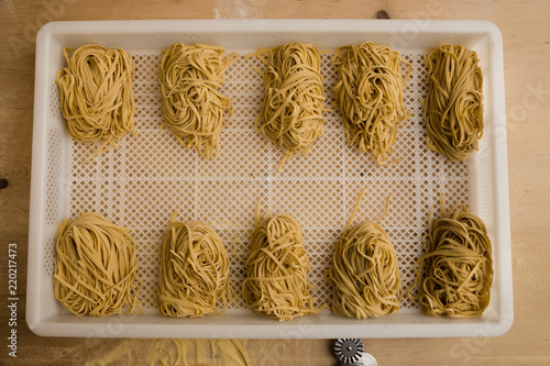 Obraz Overhead shot of rows of freshly made pasta. - fototapety do salonu