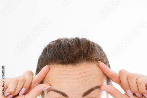 Fotografering  Macro Woman face with wrinkles on the forehead