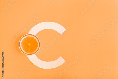 Photo Orange and letter C on a yellow background